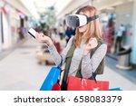female shopper experiencing... | Shutterstock . vector #658083379