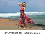 a girl in a dress on a stony... | Shutterstock . vector #658101118