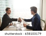 two satisfied businessmen... | Shutterstock . vector #658103179