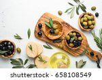 black and green olives in... | Shutterstock . vector #658108549