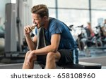 sweaty young man eating energy... | Shutterstock . vector #658108960