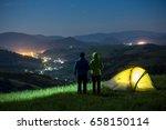 tourists standing near the tent.... | Shutterstock . vector #658150114