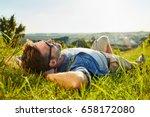 man lying on grass enjoying... | Shutterstock . vector #658172080