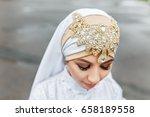 happy islamic bride in white... | Shutterstock . vector #658189558