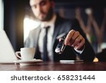 businessman at a coffee place ... | Shutterstock . vector #658231444