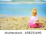 baby girl playing in the sand... | Shutterstock . vector #658251640