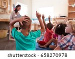 pupils at montessori school... | Shutterstock . vector #658270978