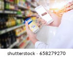 woman scanning barcode from a... | Shutterstock . vector #658279270
