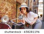 hipster girl in italy uses...   Shutterstock . vector #658281196