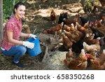 Cheerful Woman Farmer Standing...