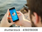 man on the coast using his... | Shutterstock . vector #658358308