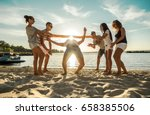 friends funny game on the beach ... | Shutterstock . vector #658385506