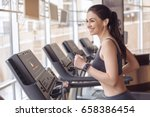 young woman workout in gym... | Shutterstock . vector #658386454