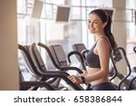 young woman workout in gym... | Shutterstock . vector #658386844