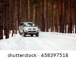 Suv Rides On A Winter Forest...