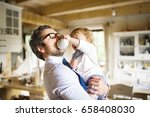businessman holding little son...   Shutterstock . vector #658408030