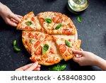 people hands taking slices of... | Shutterstock . vector #658408300
