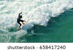 surfer in foaming water  san... | Shutterstock . vector #658417240