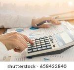 businessman using a calculator... | Shutterstock . vector #658432840