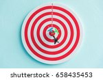 Stock photo dart in target red circle center of the target dartboard 658435453