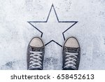 sneakers on the road with star... | Shutterstock . vector #658452613
