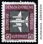 """Small photo of MOSCOW, RUSSIA - APRIL 2, 2017: A post stamp printed in DDR (Germany) from the """"Airmail """" issue shows Aircraft, circa 1957"""