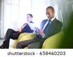young businessman using digital ... | Shutterstock . vector #658460203