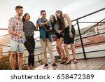 outdoor shot of young man... | Shutterstock . vector #658472389