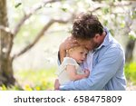 a good father is holding and... | Shutterstock . vector #658475809