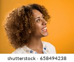 portrait of a beautiful african ... | Shutterstock . vector #658494238