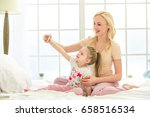young mother and daughter... | Shutterstock . vector #658516534