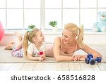 young mother and daughter... | Shutterstock . vector #658516828