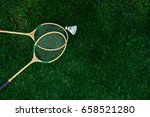 badminton racket on the green   ... | Shutterstock . vector #658521280