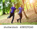 two guys running on a forrest... | Shutterstock . vector #658529260