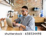 serious man working on laptop.... | Shutterstock . vector #658534498