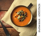 roasted pumpkin soup in metal... | Shutterstock . vector #658535626