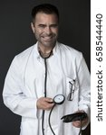 handsome doctor holding a...   Shutterstock . vector #658544440