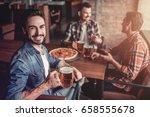 happy handsome man in bar is... | Shutterstock . vector #658555678