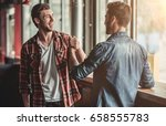 meeting of two handsome male... | Shutterstock . vector #658555783