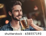 handsome young man is drinking... | Shutterstock . vector #658557193
