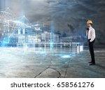 businessman architect analyzes... | Shutterstock . vector #658561276