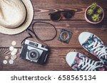 travel accessories on wooden... | Shutterstock . vector #658565134