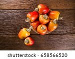 some cashew fruit over a wooden ... | Shutterstock . vector #658566520