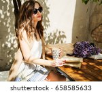 outdoors fashion portrait of...   Shutterstock . vector #658585633