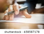 Small photo of Young businessman gives pen and documents agreement with customer to sign contract. Concept agreement