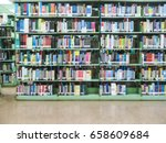 books in the library  blurred  | Shutterstock . vector #658609684