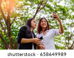 two happy young asian woman... | Shutterstock . vector #658649989