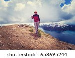 hiking man in canadian... | Shutterstock . vector #658695244