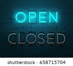 neon open sign on brick wall... | Shutterstock .eps vector #658715704