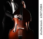 Small photo of Double bass player playing contrabass musical instrument Classical musician